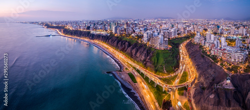 Fotografie, Obraz Aerial view of Lima city from Miraflores at blue time.