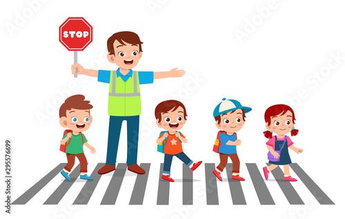 Fotografiet happy good man help kids cross road