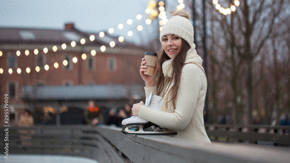 Fototapety, obrazy: Charming young woman in the Park near the ice rink. Smiling brunette with skates