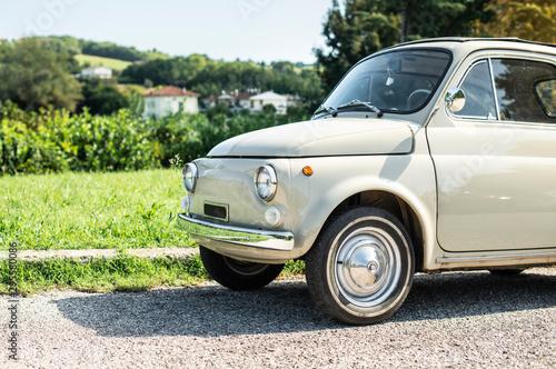 Foto op Aluminium Vintage cars Vintage beige color car. Small old car. Italian car.