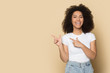 Happy african American girl point at blank copy space