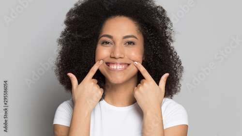 Fotografie, Tablou Happy biracial girl show bright smile ask be positive