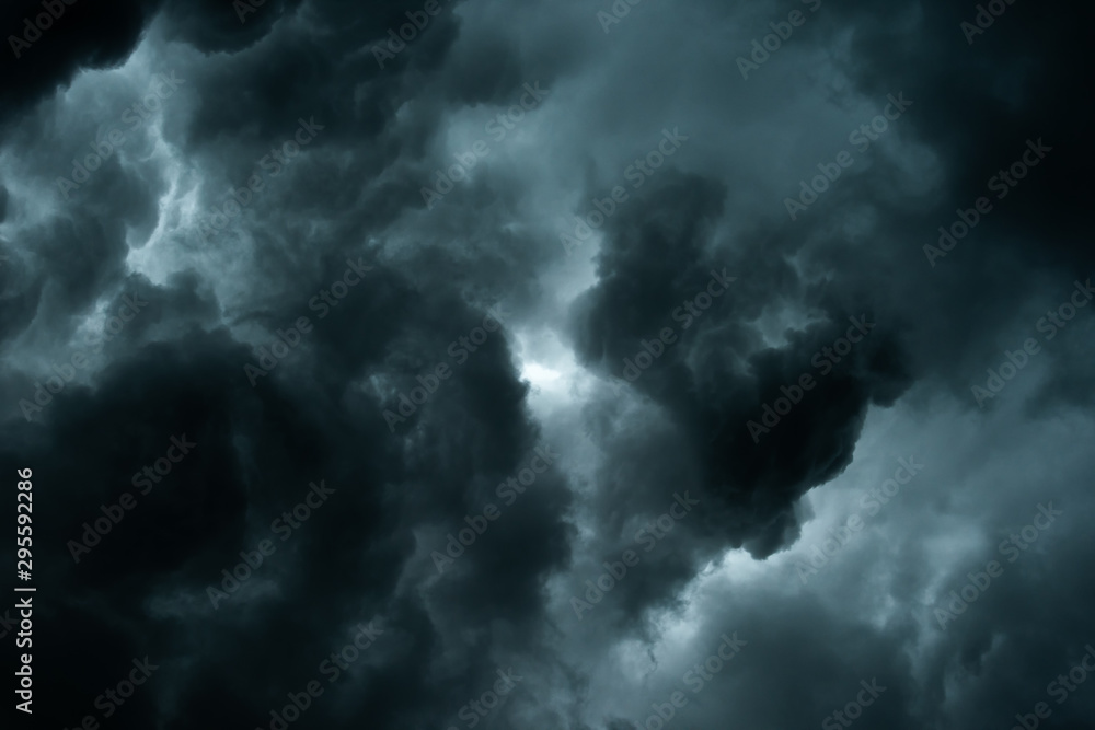 Fototapeta Storm clouds dramatic with black clouds and moody sky, Motion dark sky before rainy