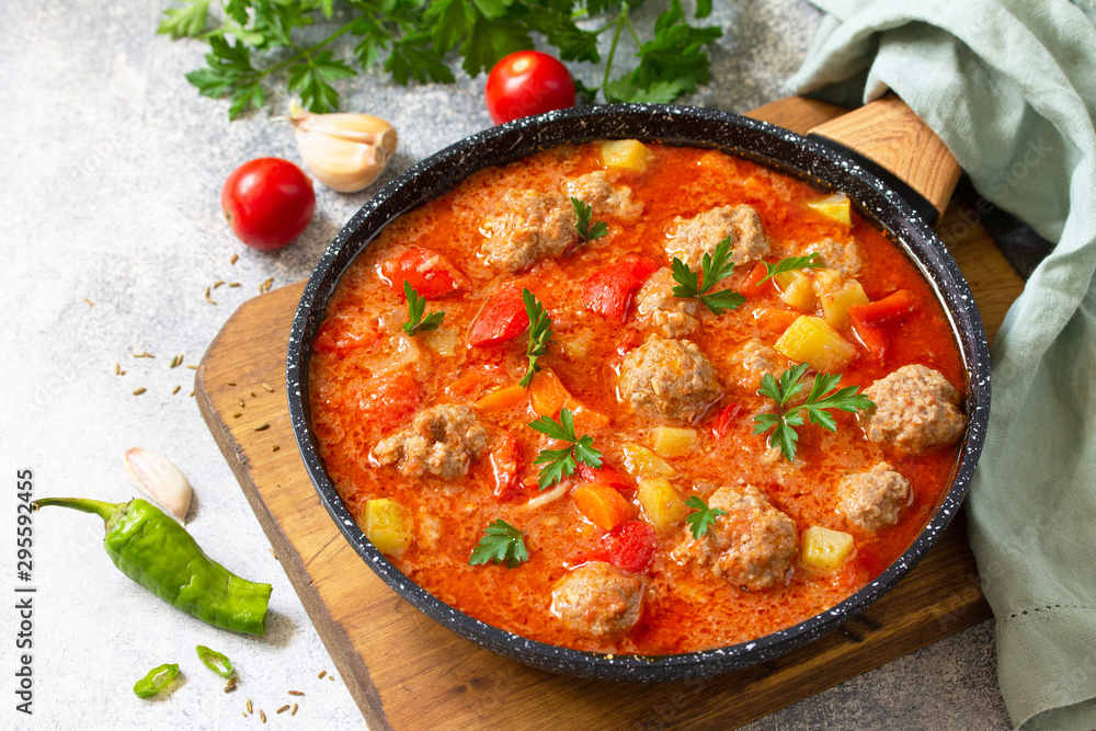 Fototapety, obrazy: Spanish and Mexican food - Albondigas. Hot stew tomato soup with meatballs and vegetables. Free space for your text.