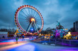canvas print picture - Christmas market near the Neptune Fountain in Berlin with Ferris wheel and ice rink in winter