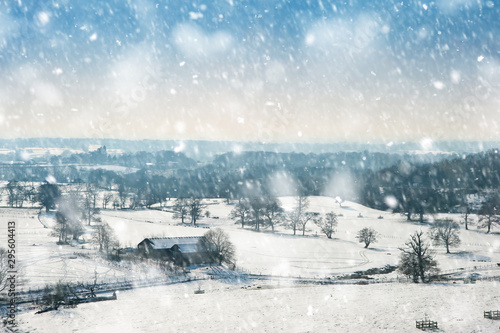 Foto auf Gartenposter Blau Winter rural countryside landscape on bright blue sky day in heavy snow storm