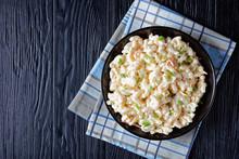 Cold Macaroni Salad In A Black Bowl