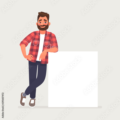 Obraz Bearded man is leaning on a blank poster. A place to post your advertisement or other information. Advertising - fototapety do salonu