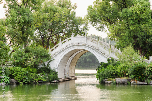 Evening view of white twin marble bridge on lake. Guilin