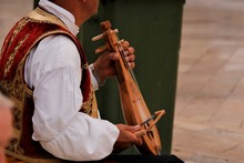 Croatian Street Musican In Tradional Costume Playing A Typical Dalmatian Lute Called Lijerica In Dubrovnik