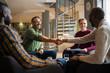 Leinwanddruck Bild - Hand Shake. Diverse South African business meeting in modern office space
