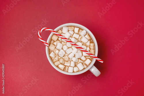 Recess Fitting Chocolate White Cup of Hot Chocolate Cocoa with Marshmallows on Red Background Candy Cane on Cup Top View Horizontal Copy Space