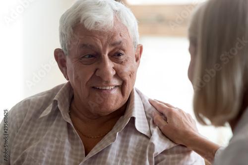 Close up view focus on elderly patient communicates with nurse