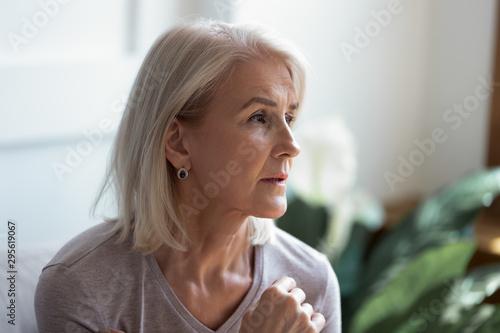 Close up image serious pensive sad aged female Wallpaper Mural