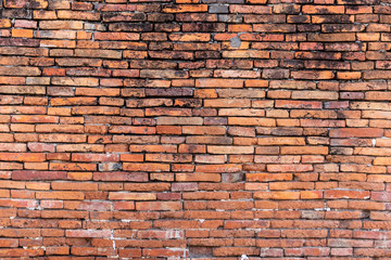 brick walls background and texture. The texture of the brick is orange. Background of empty brick basement wall.