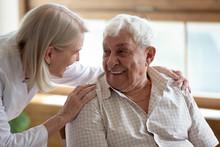 Caring Nurse Talking To Elderly Patient 80s Man