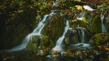Shallow Focused Shot Of A Majestic Waterfall Flowing Through Rocks Covered In Moss In Croatia