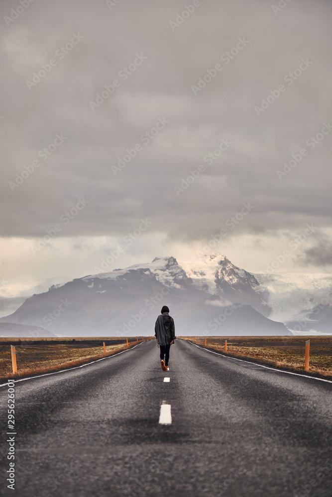 Fototapeta man on road