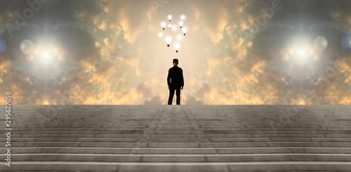 Bright ideas. Light bulbs hovers over a man Fototapeta