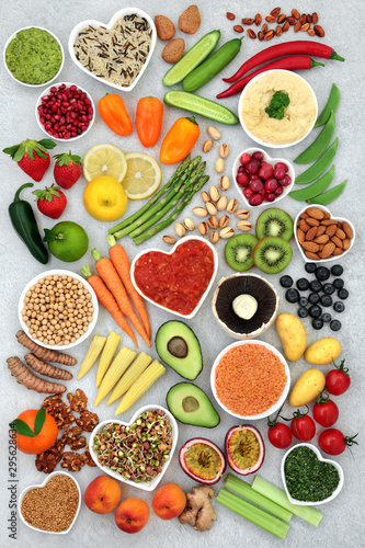 Fototapeta Vegan health food concept with nuts, seeds, fruit, vegetables, legumes, grains, spice& dips. Foods high in antioxidants, anthocyanins, omega 3, vitamins, minerals dietary fibre, smart carbs & protein. obraz