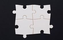 Four Puzzle Pieces, On Black B...