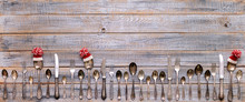 Merry Christmas! Vintage Cutlery In Santa Claus Hats On Old Wooden Background.