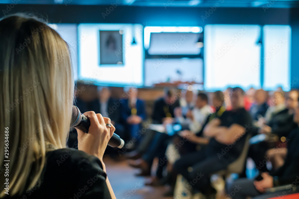 Fototapeta Female presenter speaks to audiences