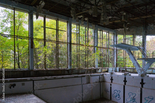 Photo  Abandoned Swimming Pool in the Evacuated City of Pripyat in the Chernobyl Exclus