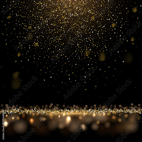 Cuadros en Lienzo Gold glitter and shiny golden rain on black background