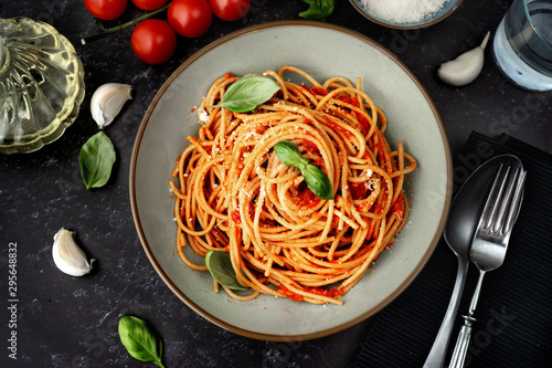 Close up of spaghetti with tomato sauce on black background Fototapeta