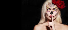 Beautiful Halloween Make-Up Style. Blond Model Wear Sugar Skull Makeup With Red Roses. Santa Muerte Concept