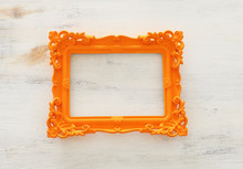 Blank Orange Photo Frame Over White Background. Ready For Photography Montage. Top View Flat Lay