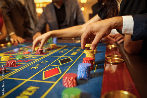 Cuadros en Lienzo A group of people gamblers playing gambling poker roulette in a casino