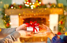 Christmas Gift In Hands. Happy...
