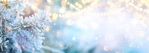 Obraz Christmas background. Xmas tree with snow decorated with garland lights, holiday festive background. Widescreen frame backdrop. New year Winter art design, Christmas scene wide screen holiday border - fototapety do salonu
