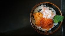 A Bowl Of Rice With Sashimi On...
