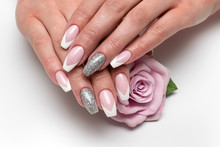 Wedding Sharp French Manicure With Silver Sequins On The Ring Fingers On A White Background Close-up On Long Nails With A Pink Rose In Hand