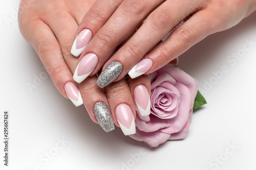 Valokuva Wedding sharp French manicure with silver sequins on the ring fingers on a white