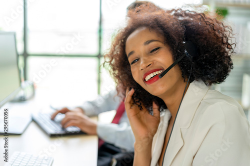 Young woman is a customer service agent at office workplace Canvas-taulu