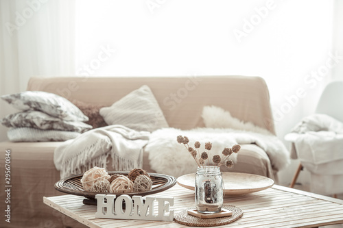 Photo  Cozy bright living room with sofa and pillows.