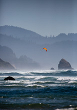 Kitesufer With A Orange Kite O...