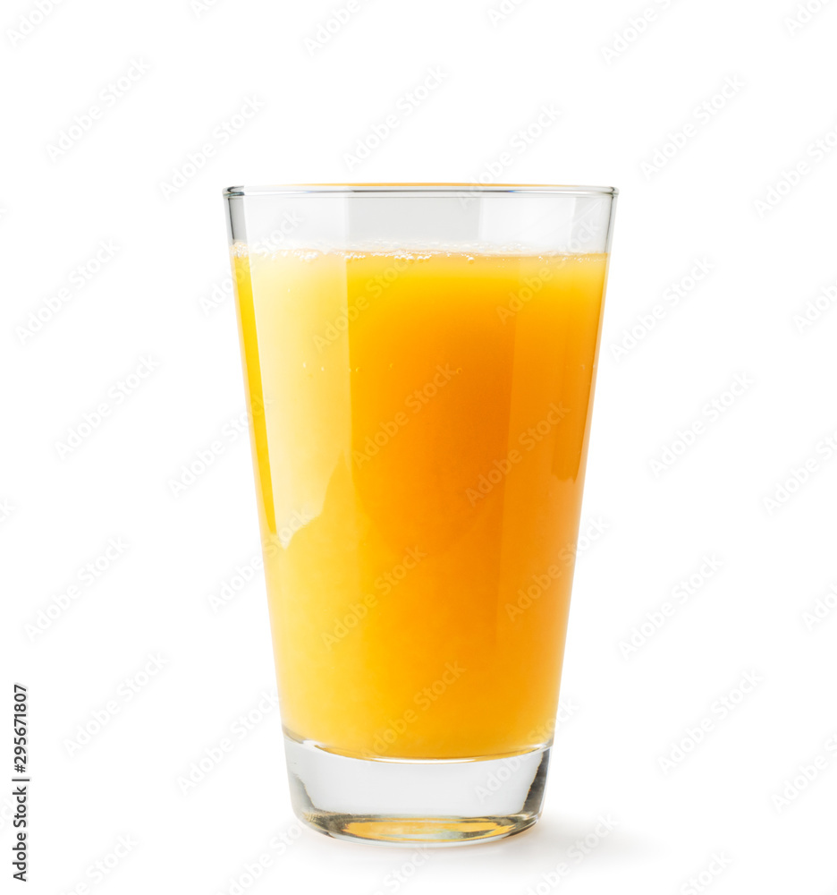 Fototapeta Orange juice in a glass close-up on a white. Isolated