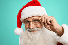 Happy Authentic Santa Claus In Red Hat And Eyeglasses