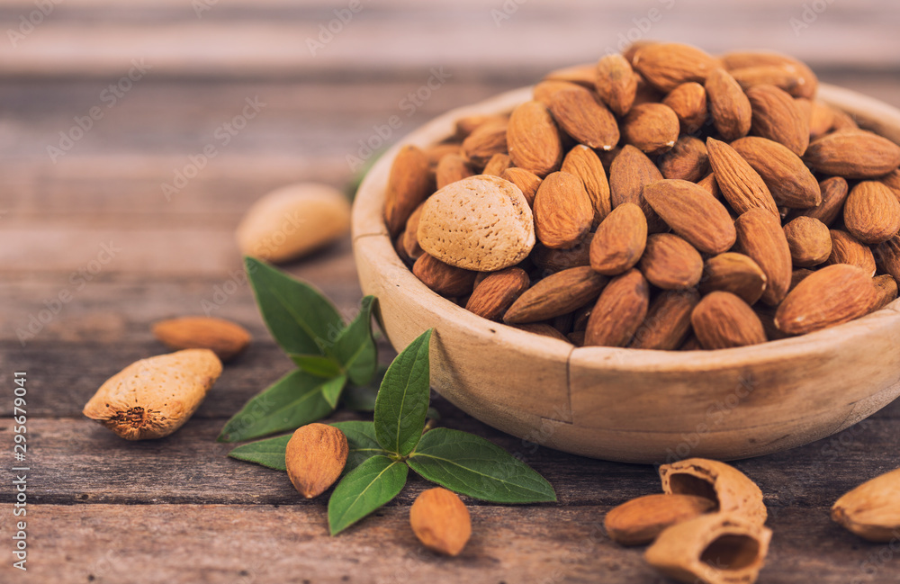 Fototapety, obrazy: Fresh almonds in the wooden bowl