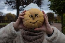 A Teenage Girl And A Pumpkin I...
