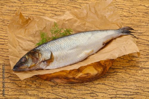 Salted herring over the wooden board Canvas Print