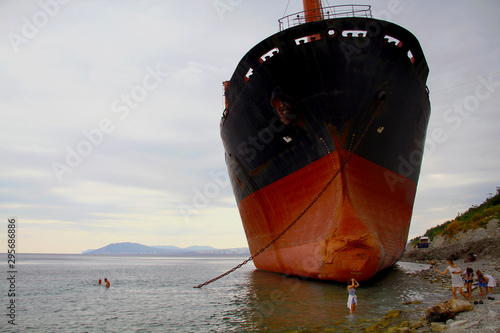 Gelendzhik, Russia - July 15, 2019: a ship called Rio after a storm, ran aground on the Black Sea Wallpaper Mural