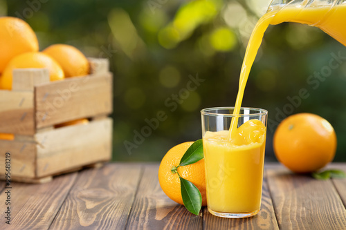 orange juice pouring in glass - 295688219