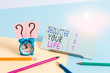 Leinwandbild Motiv Writing note showing Declutter Your Life. Business concept for To eliminate extraneous things or information in life Mini size alarm clock beside stationary on pastel backdrop