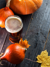 A Glass Of Traditional Pumpkin Beer Ale On A Wooden Table Copy Space